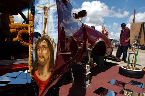 Jesus Christ is depicted on the inside of the door of a 1982 Buick Regal during the Low and Slow Classic Car Show at Mateo Camargo Park Sunday. The car, called Aztlan Warrior, is owned by Alex Chavez. John Davenport / Staff
