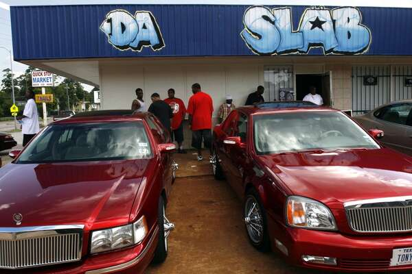 "SLAB owners hang out in front of Da SLAB Spot where their ""Slow, Loud and Bangin'"" vehicles are created."