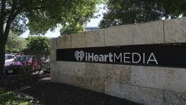 San Antonio-based iHeartMedia is burning cash as it approaches a wall of repayments over the next two years, according to a Fitch report that reduced the long-term issuer default rating to CC from CCC.