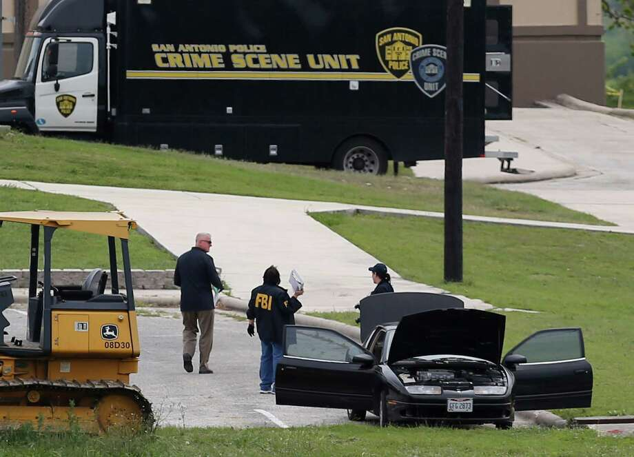 FBI personnel stand near a vehicle located inside Lackland AFB, Medina Annex on Friday, Apr. 8, 2016. Earlier, two men died in an apparent murder-suicide near Forbes Hall within the annex Friday morning that left the base locked down for nearly 2 hours, officials said. (Kin Man Hui/San Antonio Express-News) Photo: Kin Man Hui, Staff / San Antonio Express-News / ©2016 San Antonio Express-News
