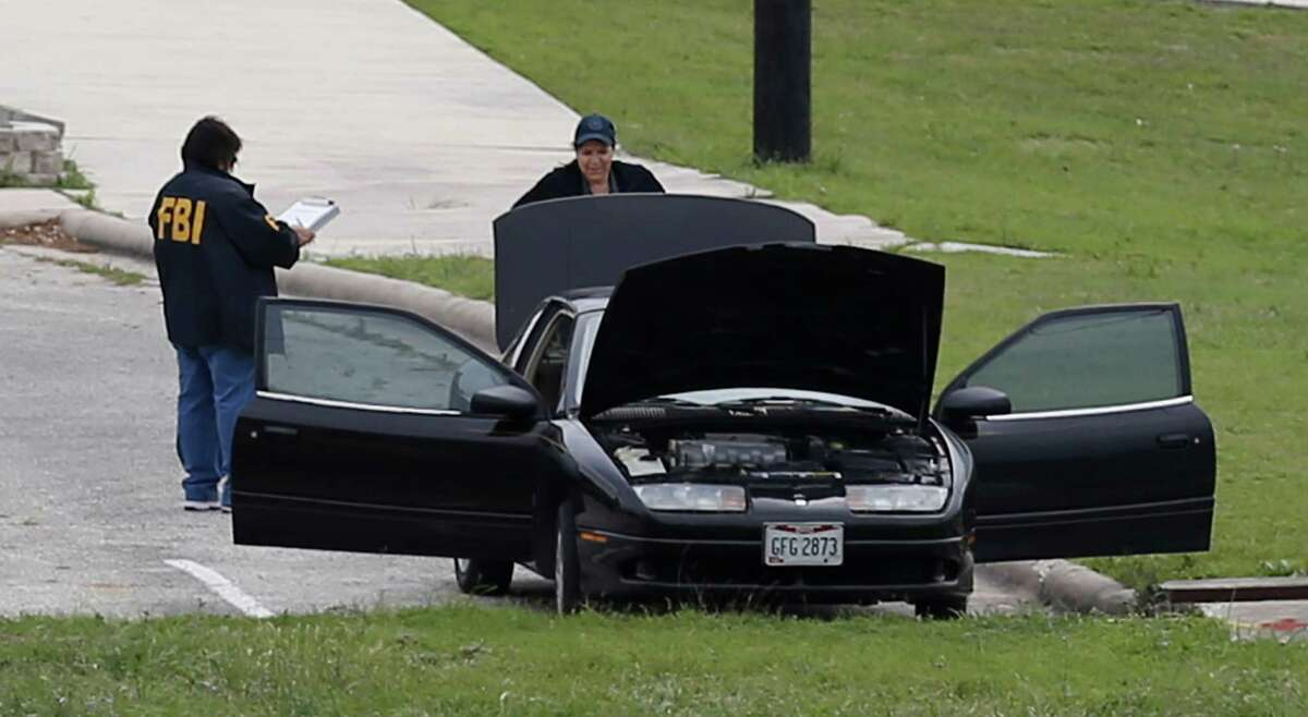 FBI personnel stand near a vehicle located inside Lackland AFB, Medina Annex on Friday, Apr. 8, 2016. Earlier, two men died in an apparent murder-suicide near Forbes Hall within the annex Friday morning that left the base locked down for nearly 2 hours, officials said. (Kin Man Hui/San Antonio Express-News)