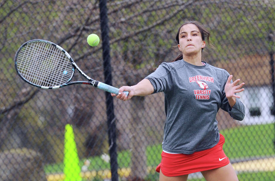 Maddie Arnold of GHS hits in her match against GA's Georgia Ryan during the girls high school tennis match between Greenwich Academy and Greenwich High School at Greenwich Academy, Conn., Friday afternoon, April 8, 2016. Photo: Bob Luckey Jr. / Hearst Connecticut Media / Greenwich Time