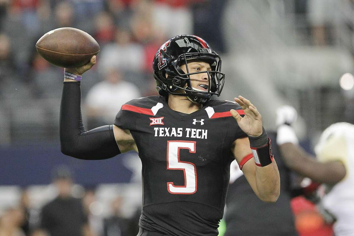 FILE - In this Nov. 29, 2014, file photo, Texas Tech quarterback Patrick Mahomes (5) throws a pass during the first half of an NCAA college football game against in Arlington, Texas. Texas Tech coach Kliff Kingsbury calls his options at quarterback this season a �luxury.� Sophomore Mahomes and junior Davis Webb will vie for the starting spot. (AP Photo/Tim Sharp, File)