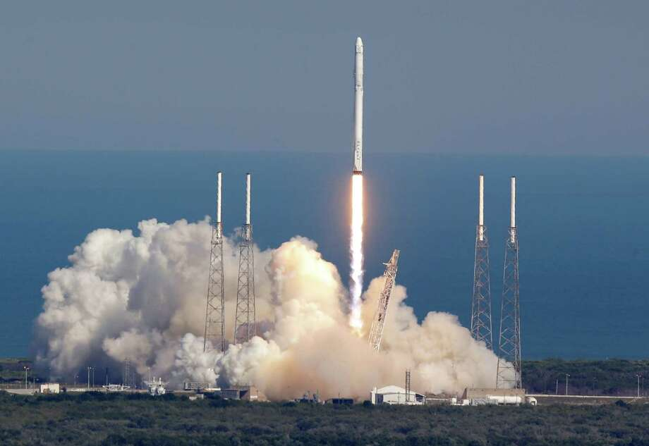 The SpaceX Falcon 9 rocket lifts off Friday at the Kennedy Space Center in Cape Canaveral, Fla. The firm landed the rocket's first stage on a sea platform. Photo: John Raoux, STF