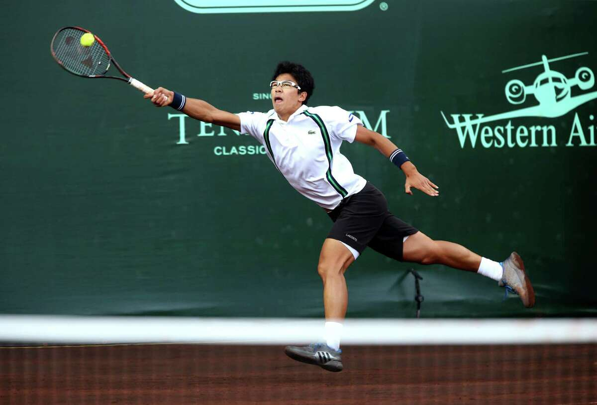 Hyeon Chung (KOR) reachers for a serve by John Isner (USA) in a quarter final match at the U.S. Men's Clay Court Championships at River Oaks Country Club, Friday, April 8, 2016, in Houston, Texas. Isner won, 7-6(5), 6-4.
