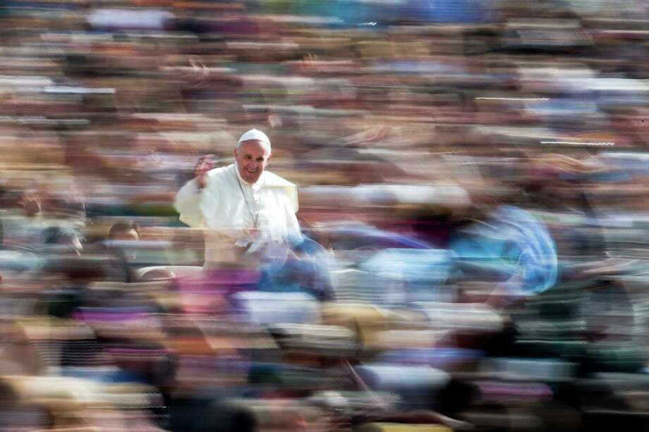 Pope Francis waves to the crowd as he arrives on his pope-mobile for his weekly general audience, in St. Peter's Square at the Vatican, Wednesday, April 6, 2016. (AP Photo/Andrew Medichini) Photo: Andrew Medichini, STF / AP / AP