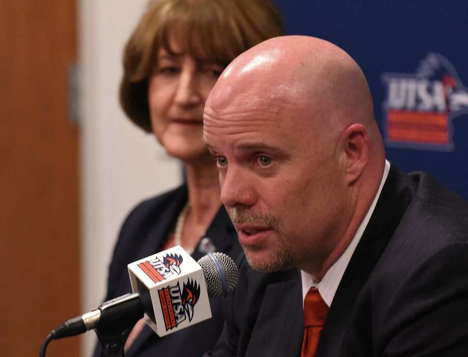 NEW UTSA head basketball coach Steve Henson speaks as athletic director Lynn Hickey listens during a press conference at the H-E-B University Center on Friday, April 8, 2016. Henson was most recently an assistant coach at Oklahoma during their run to the Final Four. Photo: Billy Calzada, Staff / San Antonio Express-News / San Antonio Express-News