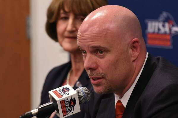 NEW UTSA head basketball coach Steve Henson speaks as athletic director Lynn Hickey listens during a press conference at the H-E-B University Center on Friday, April 8, 2016. Henson was most recently an assistant coach at Oklahoma during their run to the Final Four.