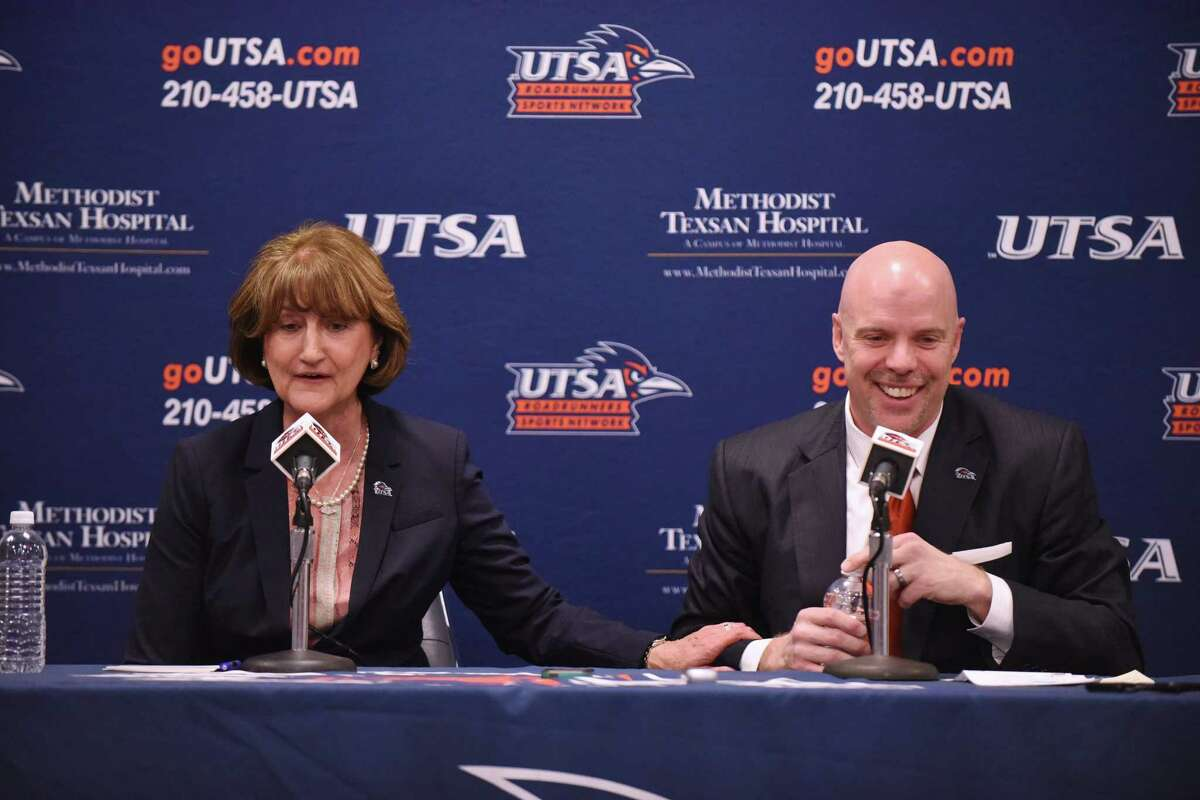 NEW UTSA head basketball coach Steve Henson, right, and athletic director Lynn Hickey share a moment of levity during a press conference at the H-E-B University Center on Friday, April 8, 2016. Henson was most recently an assistant coach at Oklahoma during their run to the Final Four.