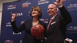 "UTSA men's basketball coach Steve Henson and athletic director Lynn Hickey flash the ""Bird's Up!"" sign during a press conference on campus on April 8, 2016."