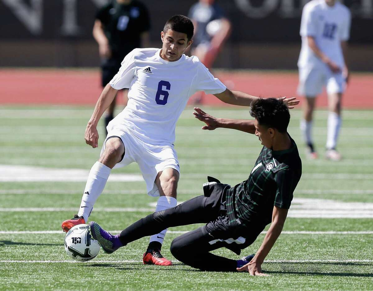 Angleton's Adrian Alcocer (6) attempts to keep the ball away from John B. Connally's Kevin Ramirez (1) in the first half against during the Class 5A Region III soccer tournament semifinals on Friday, March 8, 2016, in Humble, Texas.