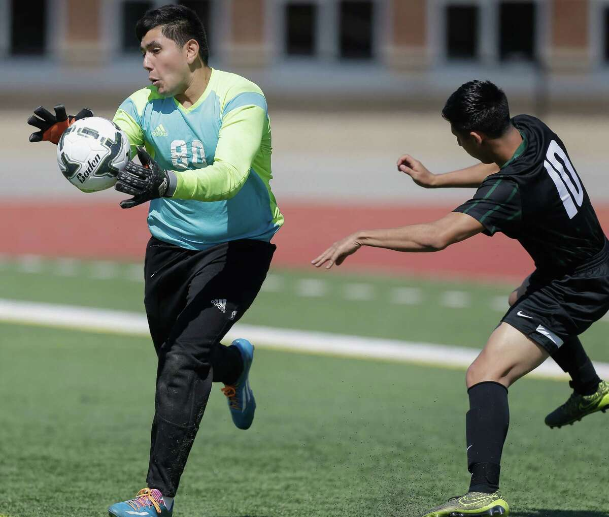 Angleton goalkeeper Jesus Ocampo (80) reaches the ball before John B. Connally's Jerson De La Rosa (10) during the Class 5A Region III soccer tournament semifinals on Friday, March 8, 2016, in Humble, Texas.