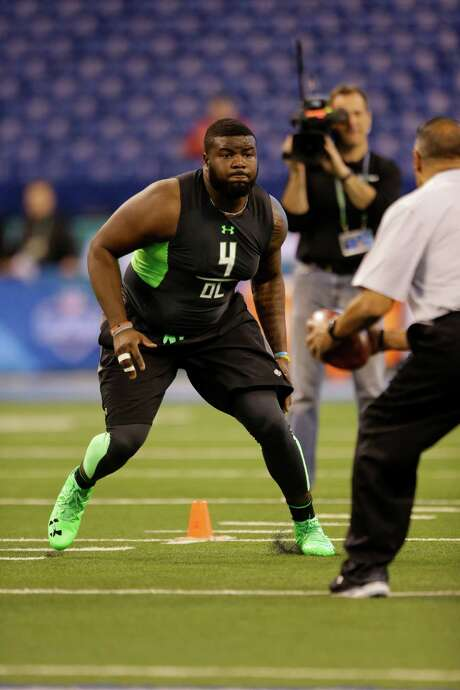 Former UCLA offensive tackle Caleb Benenoch, who performed well at the NFL combine in February, is confident he made the right decision to turn pro a year early. Photo: Michael Conroy, STF / AP