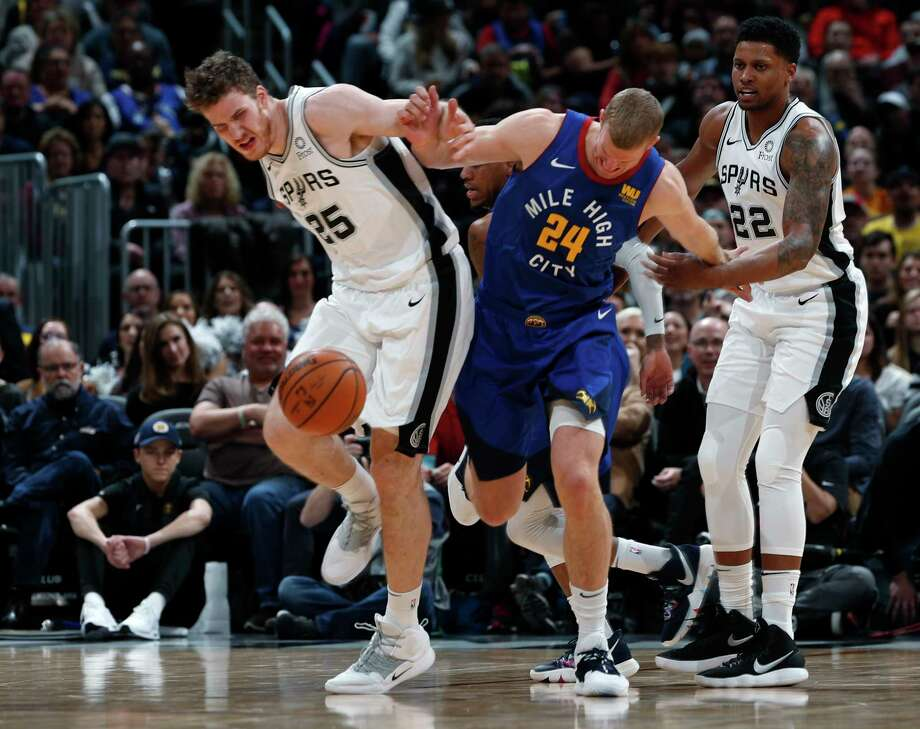 Denver Nuggets guard Will Barton, left, is fouled by San Antonio Spurs forward Rudy Gay during the first half of an NBA basketball game Friday, Feb. 23, 2018, in Denver. (AP Photo/David Zalubowski) Photo: David Zalubowski, Associated Press / Copyright 2018 The Associated Press. All rights reserved.