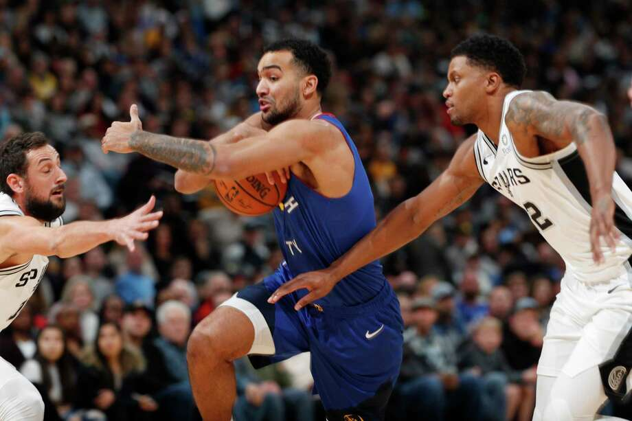 Denver Nuggets forward Trey Lyles, center, drives to the rim between San Antonio Spurs guard Marco Belinelli, left, and forward Rudy Gay in the first half of an NBA basketball game Friday, Dec. 28, 2018, in Denver. (AP Photo/David Zalubowski) Photo: David Zalubowski, Associated Press / Copyright 2018 The Associated Press. All rights reserved.
