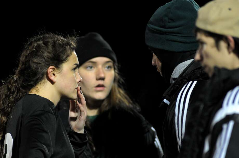 Kingwood Park senior defender Avery Harlan, left, and head coach Jess White discuss defensive strategy during halftime of the Lady Panther's game against C.E. King on Jan. 23. Photo: Jerry Baker, For The Chronicle