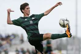 Reagan's Shane Malone kicks the ball during the first half of a Region IV-6A semifinal match agaisnt Laredo United South at the Brownsville Sports Park on April 8, 2016.