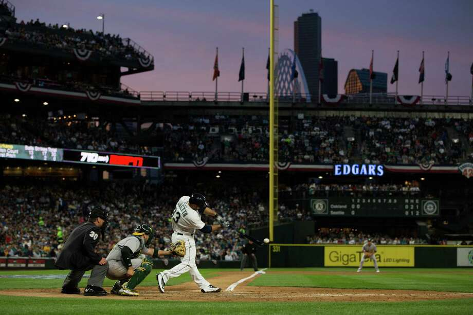 Mariners catcher Chris Iannetta gets a hit in the second inning of a baseball game against the Oakland Athletics at Safeco Field on Friday, April 8, 2016. Photo: GRANT HINDSLEY, SEATTLEPI.COM / SEATTLEPI.COM
