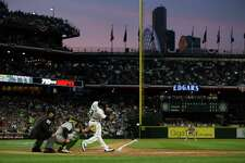 Mariners catcher Chris Iannetta gets a hit in the second inning of a baseball game against the Oakland Athletics at Safeco Field on Friday, April 8, 2016.