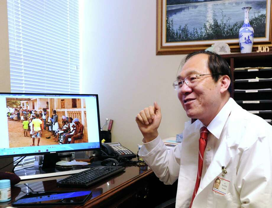 Dr. Jun Xu at his Greenwich office this week, speaking about his recent humanitarian mission to West Africa. Photo: Bob Luckey Jr. / Hearst Connecticut Media / Greenwich Time