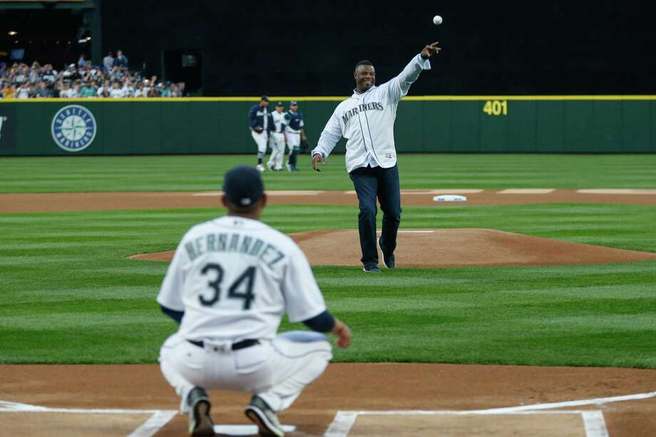 223d0eb409 Mariners great Ken Griffey Jr. throws out the ceremonial first pitch to  Felix Hernandez #