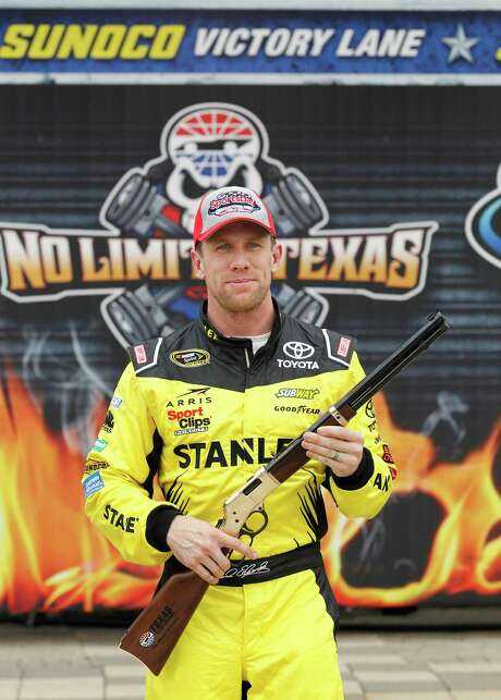 Carl Edwards will be on the pole for the Duck Commander 500, holding the Pole Winner's rifle, a gift from the Texas Motor Speedway, on Friday, April 8, 2016, in Fort Worth, Texas. (Paul Moseley/Fort Worth Star-Telegram/TNS) Photo: Paul Moseley, MBR / Fort Worth Star-Telegram