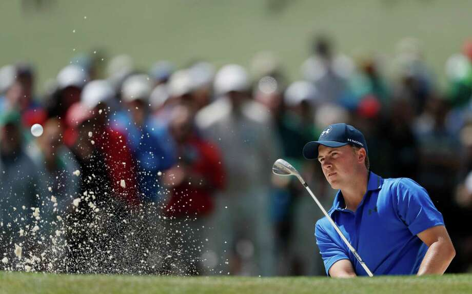 Jordan Spieth's eventful round Friday included blasting out of a bunker on the seventh hole en route to a 2-over 74. Photo: Matt Slocum, STF / AP
