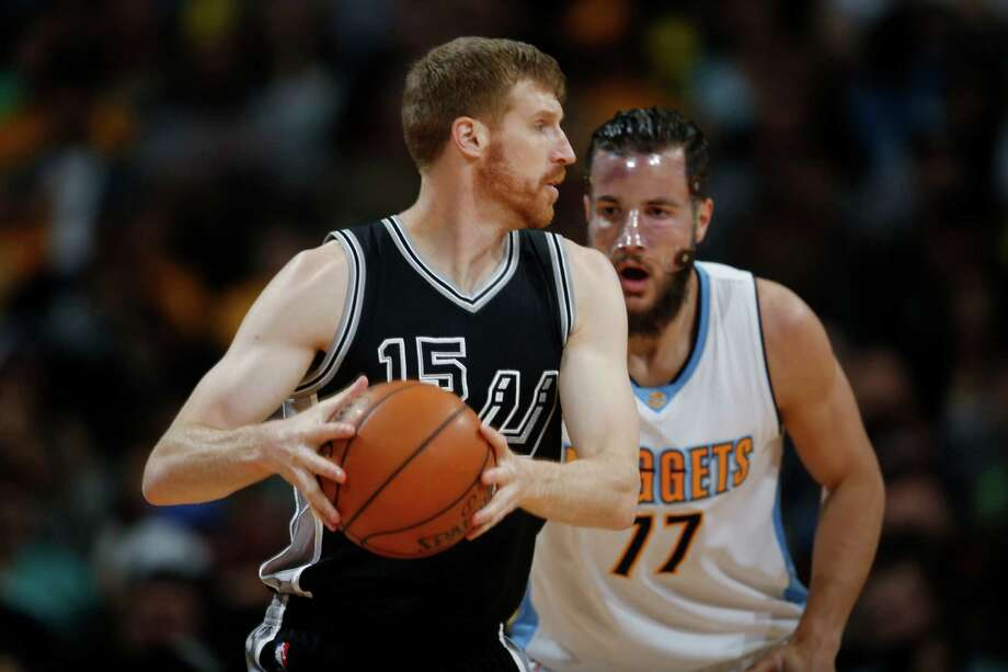 San Antonio Spurs center Matt Bonner, front, looks to pass the ball as Denver Nuggets center Joffrey Lauvergne, of France, defends in the first half of an NBA basketball game Friday, April 8, 2016, in Denver. (AP Photo/David Zalubowski) Photo: David Zalubowski, STF / AP / Copyright 2016 The Associated Press. All rights reserved. This material may not be published, broadcast, rewritten or redistribu