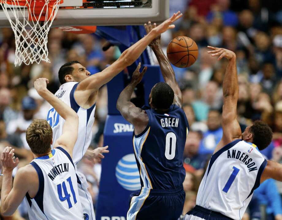Mavericks center Salah Mejri (50) blocks a shot by  Grizzlies forward JaMychal Green (0) as teammate Dirk Nowitzki (41) looks on. Photo: Jim Cowsert, FRE / FR170531 AP