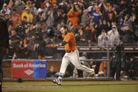 Giants' Brandon Crawford heads for home after his walk off home run in the bottom of the tenth inning as the San Francisco Giants beat the Los Angeles Dodgers 3-2 at AT&T Park in San Francisco, California on Fri. April 8, 2016.