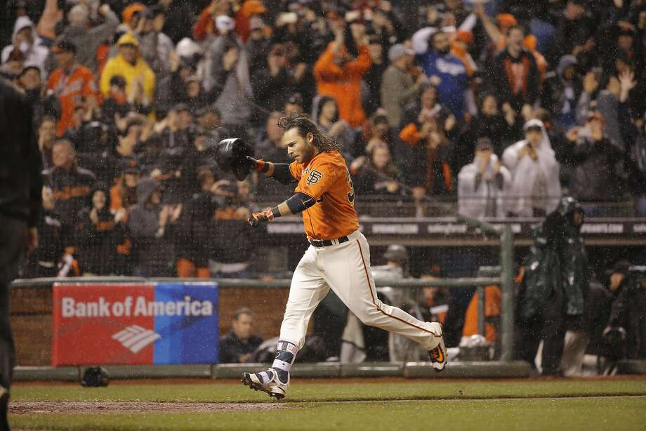Giants' Brandon Crawford heads for home after his walk off home run in the bottom of the tenth inning as the San Francisco Giants beat the Los Angeles Dodgers 3-2 at AT&T Park in San Francisco, California on Fri. April 8, 2016. Photo: Michael Macor, The Chronicle