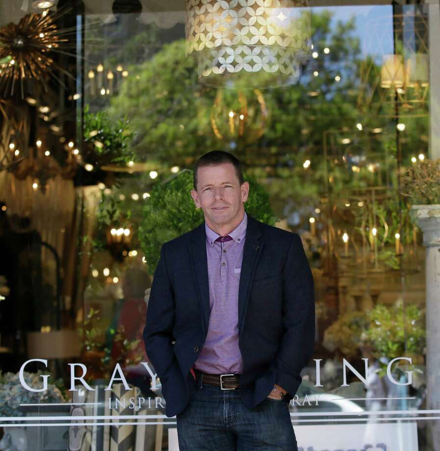 In this Thursday, March 31, 2016 photo, Randal Weeks, owner of Gray Living in poses at his retail store in McKinney, Texas. Customers' reluctance to spend has sent Weeks' sales down 12 percent so far this year from the same period of 2015. The problem goes beyond the Dallas area, Weeks also has a wholesale business, supplying merchandise to other retailers around the country, and they report their customers are hesitant too.  (AP Photo/LM Otero) Photo: LM Otero, STF / AP