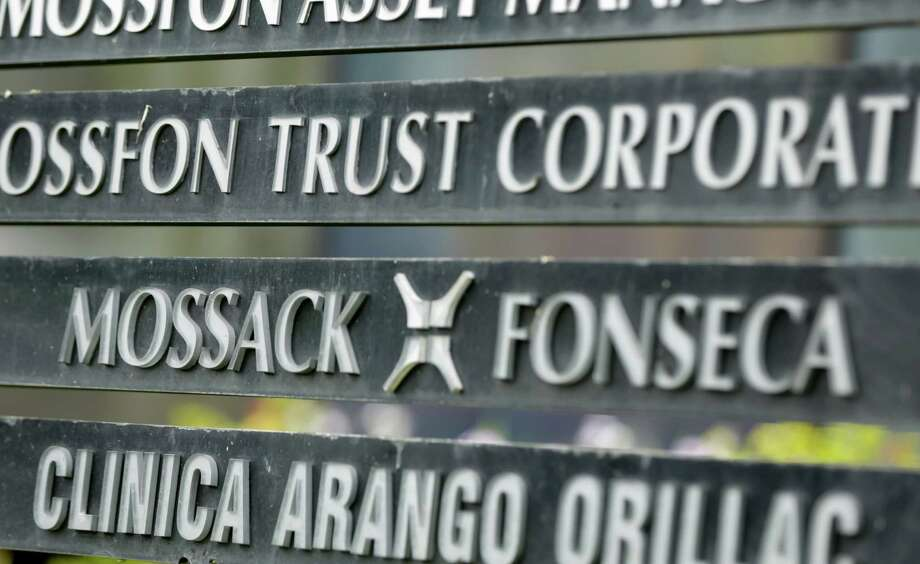 FILE - In this April 4, 2016 file photo, a marquee on a building in Panama City, Panama, lists the Mossack Fonseca law firm, one of the leaders in setting up offshore bank accounts for the rich and powerful. Offshore accounts conjure up images of malicious misdeeds, but many people use them for more than just hiding bribes and laundering money. And offshore accounts can be a financial tool for more than just the ultra-wealthy, too.  (AP Photo/Arnulfo Franco, File) Photo: Arnulfo Franco, STF / AP