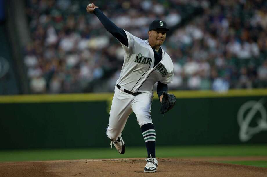 Mariners pitcher Taijuan Walker throws a pitch in the first inning during the teams' 2016 home opener against the Oakland Athletics at Safeco Field on Friday, April 8, 2016. Photo: GRANT HINDSLEY, SEATTLEPI.COM / SEATTLEPI.COM
