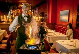 Server Robert Conso makes Bananas Foster at Alfred's Steakhouse in San Francisco, Calif., on April 7th, 2016.