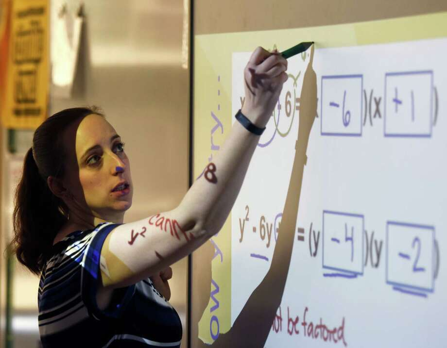 Johanna Kolar demonstrates how to factor trinomials to her eighth-grade algebra class at Western Middle School in Greenwich, Conn. Tuesday, April 5, 2016. Photo: Tyler Sizemore / Hearst Connecticut Media / Greenwich Time