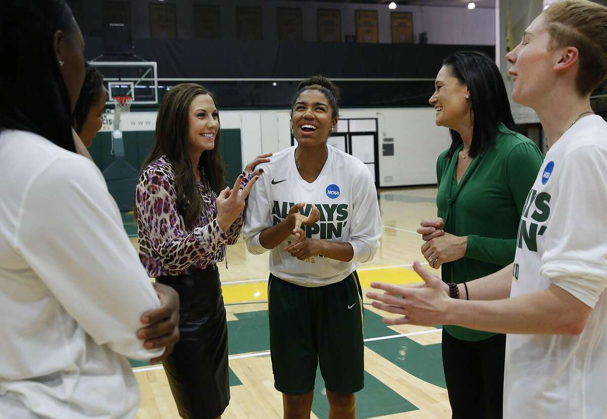 Between portrait photos, Don's women's basketball head coach Jennifer Azzi, second from right, jokes with women's basket ball associate head coach Blair Hardiek, third from left and players, from left, Hashima Carothers, Claudia Price, Kalyn Simon and Rachel Howard in the gym at University of San Francisco April 7, 2016 in San Francisco, Calif.