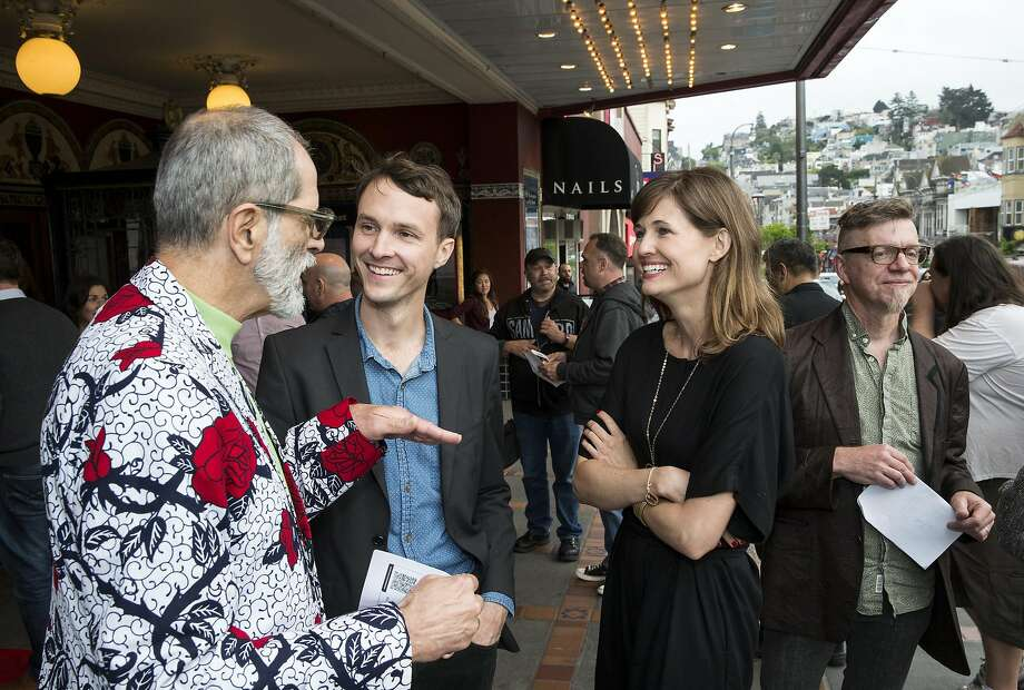 "AIDS survivor Harry Breaux (left) talks with Tim Hussin and Erin Brethauer at the premiere of their ""Last Men Standing"" film. Photo: Laura Morton, Special To The Chronicle"
