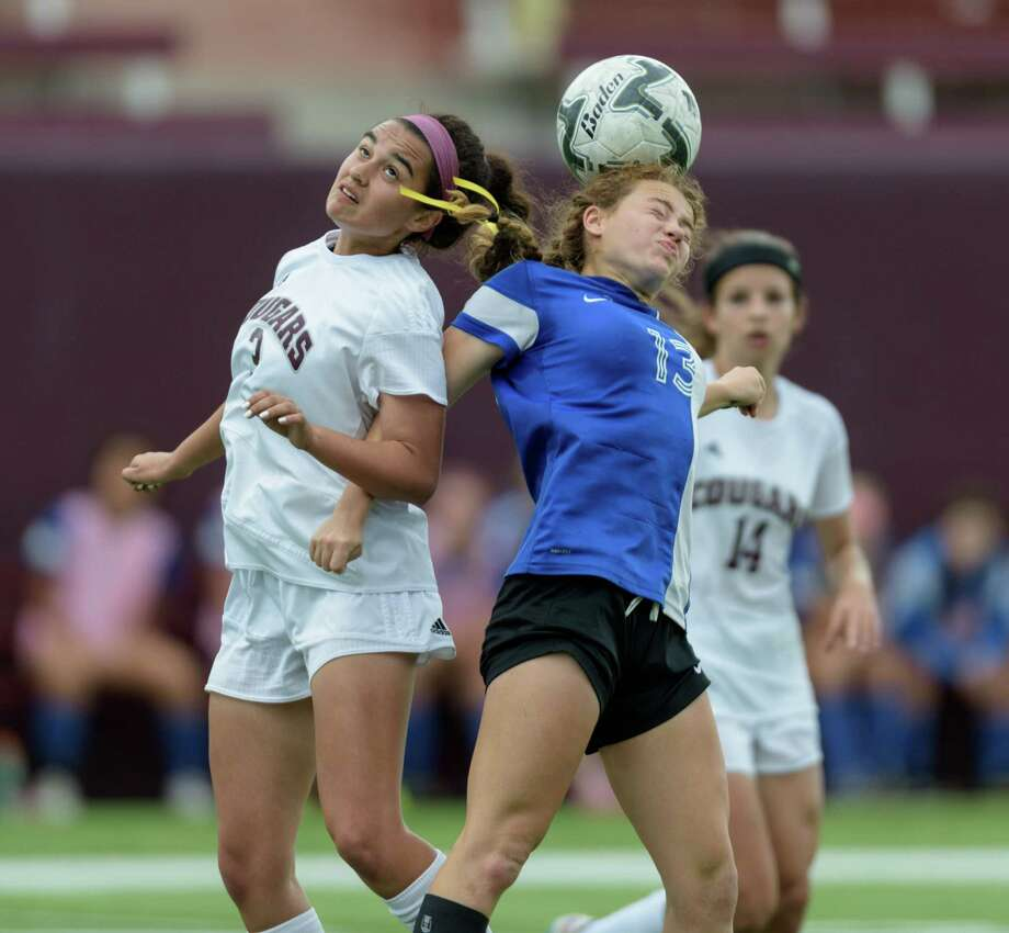 Natalie DeGeeter (13) of the Taylor Mustangs wins a header from Mary Brodeur (3) of the Cinco Ranch Cougars in the the 6A Region III Championships on Saturday, April 9, 2016 at Clyde Abshier Stadium in Deer Park Texas. Photo: Wilf Thorne, For The Chronicle / © 2016 Houston Chronicle
