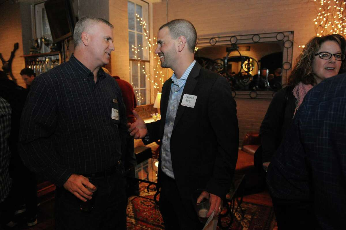 Local business members gather at Revolution Hall for a StartUp Tech Valley monthly get-together to share information and help one another on Wednesday, April 6, 2016, at Brown?s Brewing Co. in Troy, N.Y. (Michael P. Farrell/Times Union)