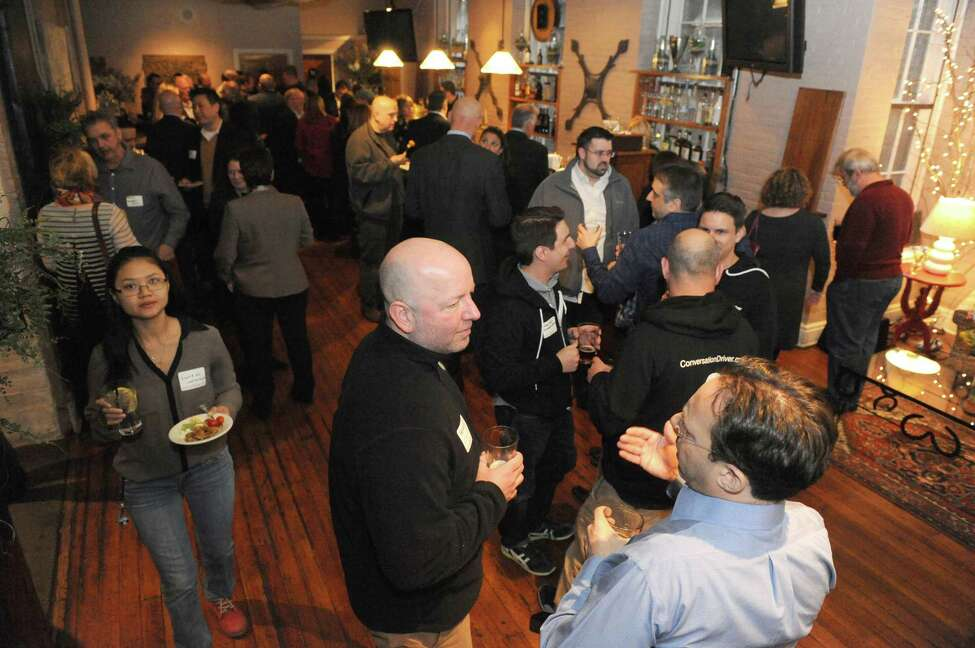 Local business members gather at Revolution Hall for a StartUp Tech Valley monthly get-together to share information and help one another on Wednesday, April 6, 2016, at Brown?s Brewing Co. in Troy, N.Y. (Michael P. Farrell/Times Union))
