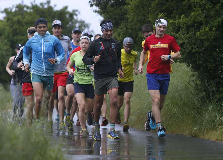 Brett Rivers (right), owner of the San Francisco Running Company in Mill Valley, Calif., leads a group of runners on a 14-mile run through the Tennessee Valley on Saturday, April 9, 2016.