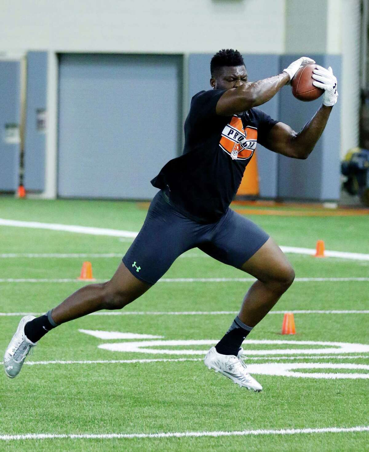 Oklahoma State's Emmanuel Ogbah catches a pass during Oklahoma State's NFL Football Pro Day at the Oklahoma State indoor practice facility in Stillwater, Okla., Tuesday, March 8, 2016.