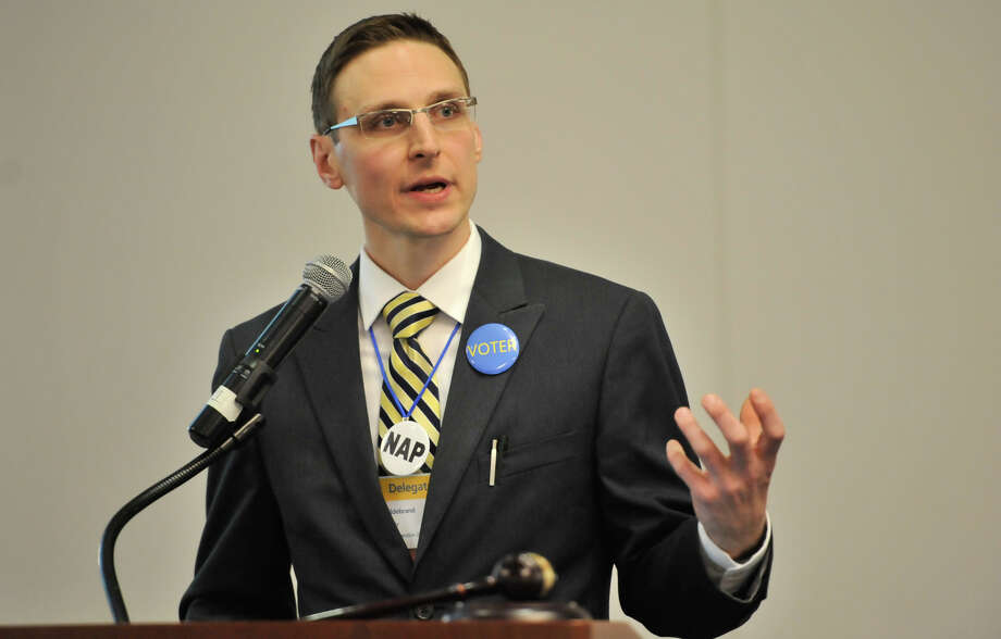 Libertarian Party Convention Chair Curt Hildebrand speaks during the convention's open day at the Norris Conference Center. Photo: Robin Jerstad / San Antonio Express-News