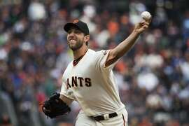 San Francisco Giants starting pitcher Madison Bumgarner (40) delivers a pitch during the first inning against the Los Angeles Dodgers at AT&T Park in San Francisco, Calif. on Saturday, April 9, 2016.