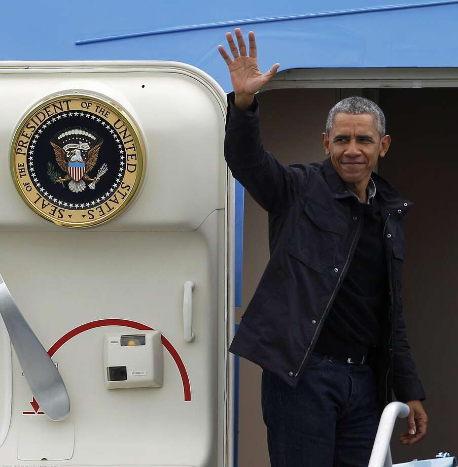 President Barack Obama waves from the doorway of  Air Force One before departing at San Francisco International Airport in San Francisco, Calif., on Saturday April 9, 2016 Photo: Brittany Murphy, The Chronicle