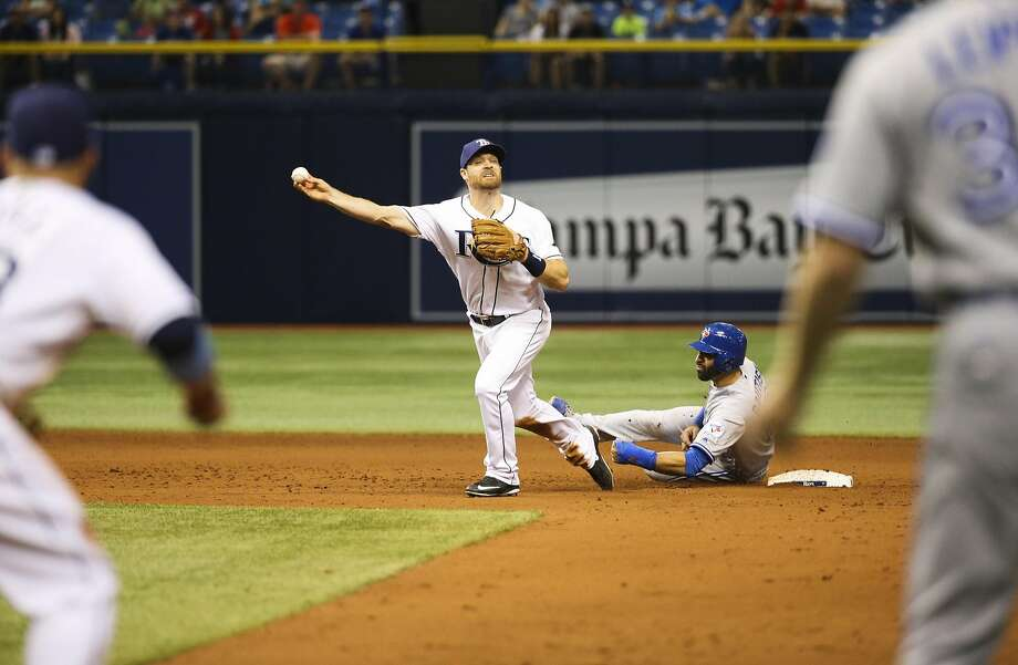 Toronto's Jose Bautista (19) slides into Tampa Bay second baseman Logan Forsythe last week. Bautista's slide was ruled to be illegal under baseball's new rules, resulting in a double play call that ended the game. Photo: Will Vragovic, AP