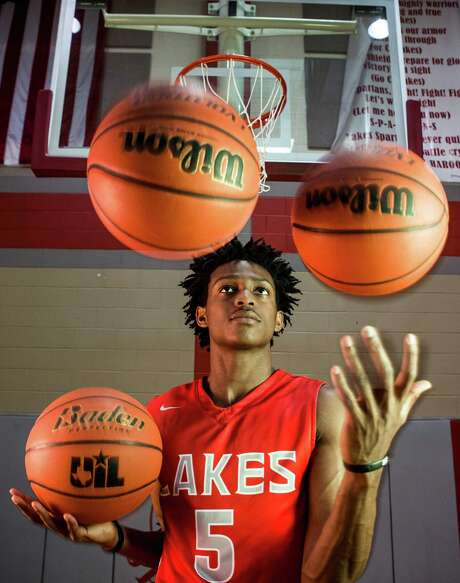 Cypress Lakes basketball player De'Aaron Fox poses for a portrait on Tuesday, March 22, 2016, in Houston. Fox is the Houston Chronicle's All-Greater Houston Boys Basketball Player of the Year. ( Brett Coomer / Houston Chronicle ) Photo: Brett Coomer, Staff / © 2016 Houston Chronicle