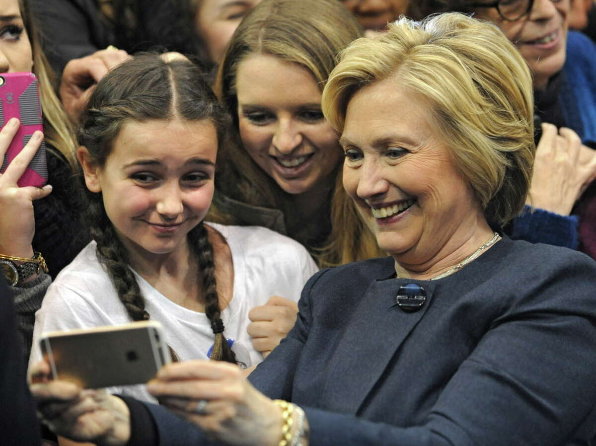 Presidential candidate Hillary Clinton greets people and has selfies taken with supporters after holding a campaign rally at Cohoes High School on Monday, April 4, 2016 in Cohoes, N.Y. (Lori Van Buren / Times Union)