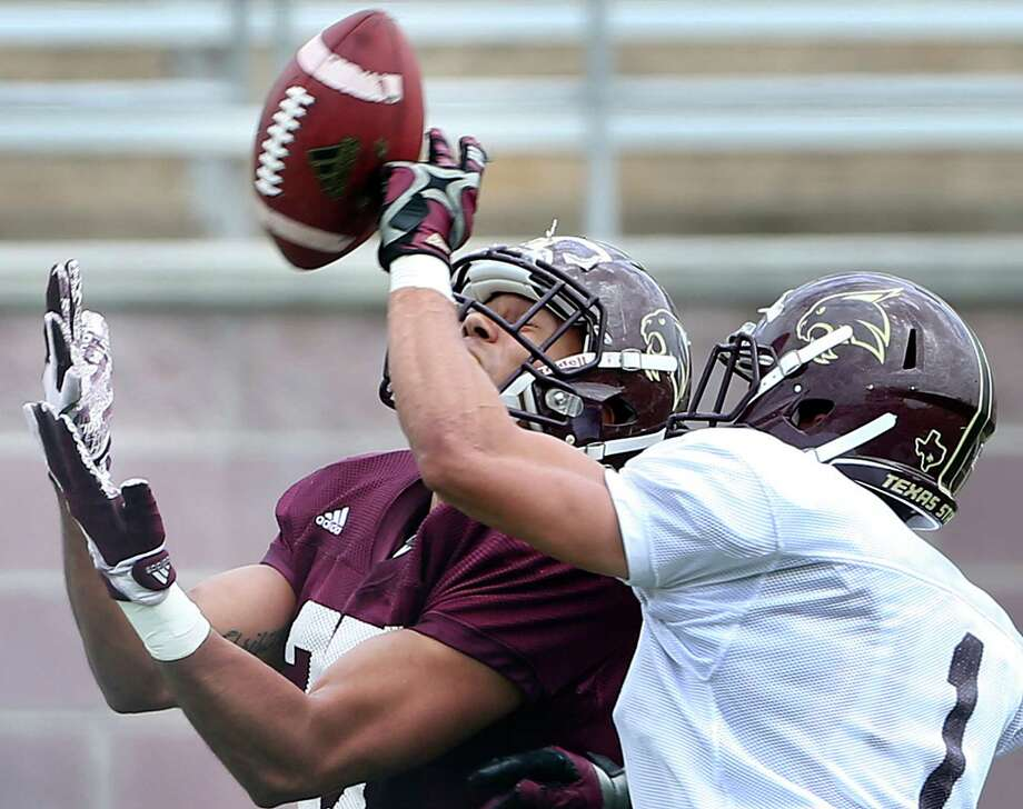 Defensive back Sean Eddington gets the tip away to stop a catch by Eric Luna as new Texas State head coach Everett Withers takes his players through the spring game at Bobcat Stadium on April 9, 2016. Photo: TOM REEL, STAFF / SAN ANTONIO EXPRESS-NEWS / 2016 SAN ANTONIO EXPRESS-NEWS